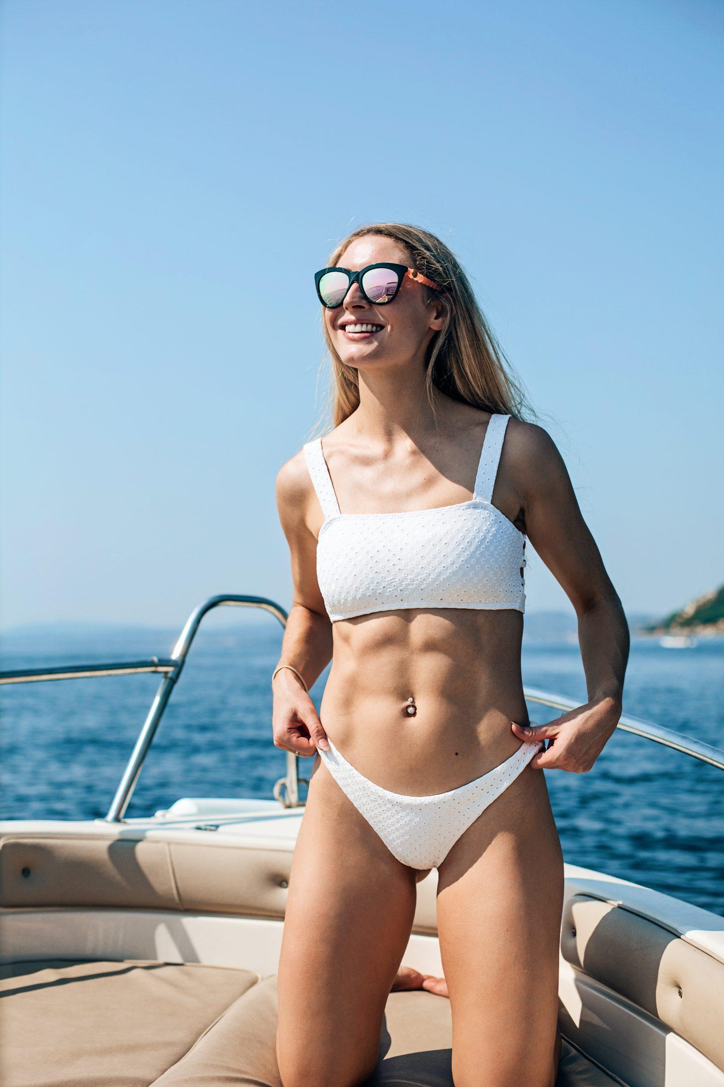 White bikini by PilyQ, and mirrored sunglasses by Brass & Unity